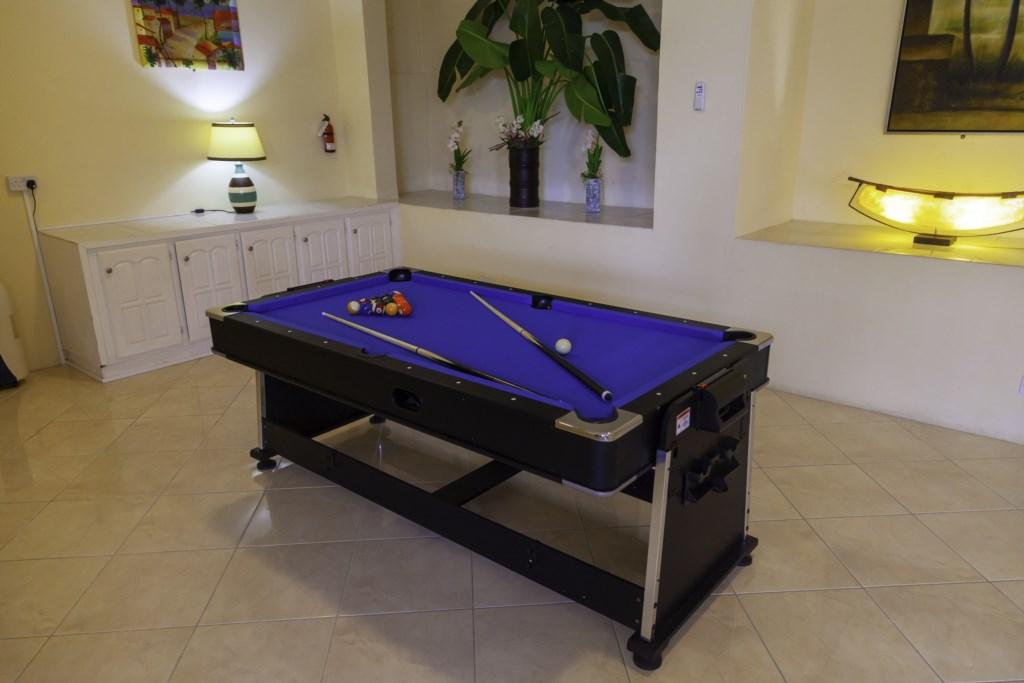 A convertible Billiard and air hockey table.