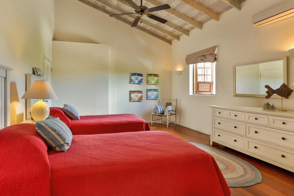 Bedroom three with two single beds than can be converted into a king bed.