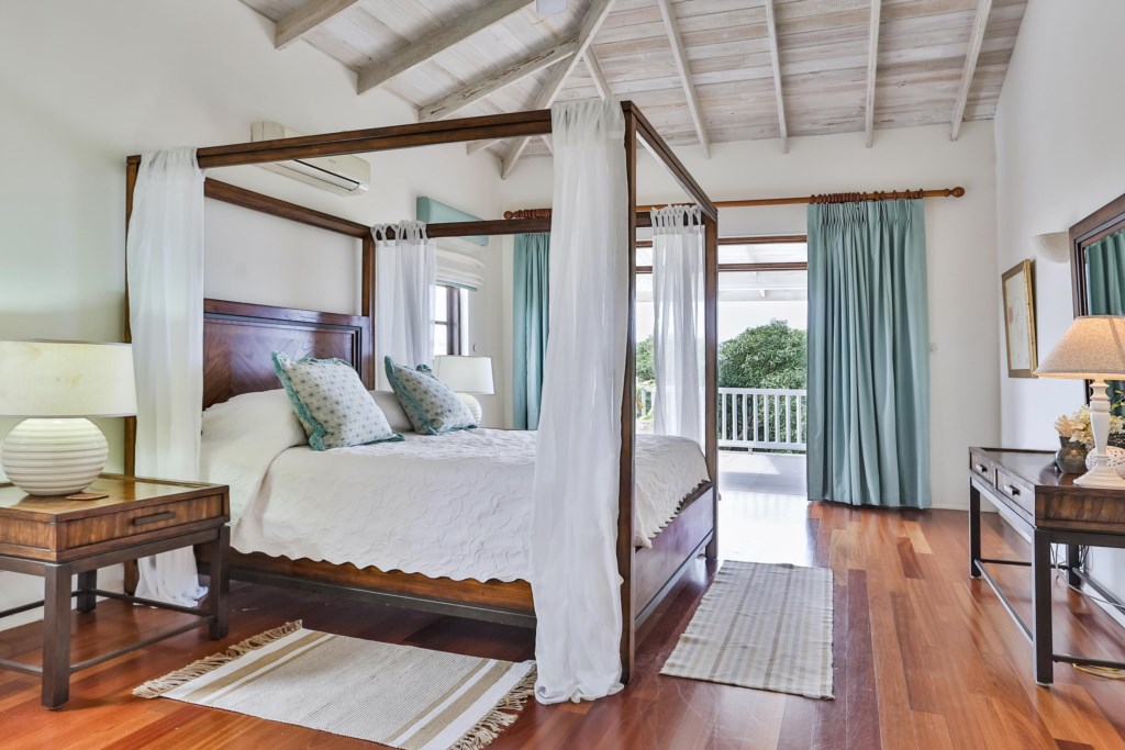 Master bedroom with four poster English king bed.