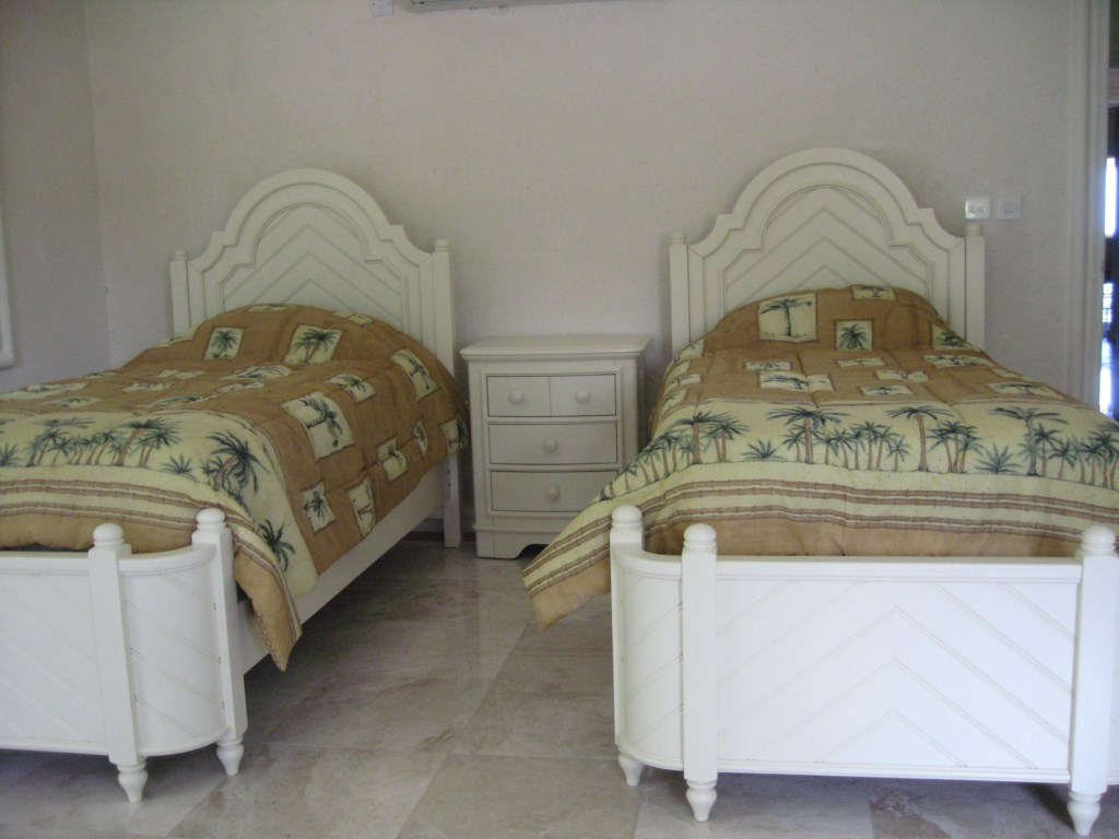 Fourth room with two twin beds that can convert into a King bed.