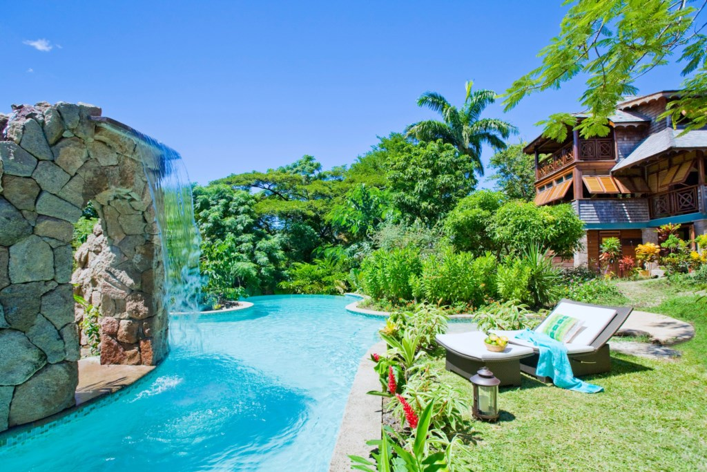 Free form pool surrounded by gardens