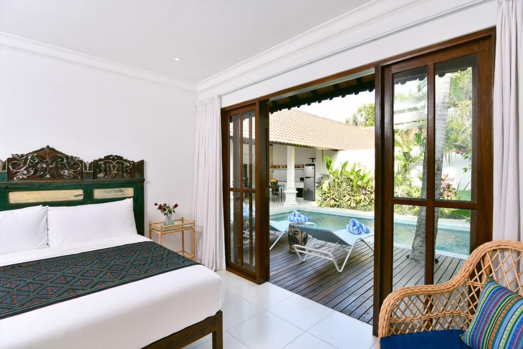 bed-pool-deck-view-villa-merah