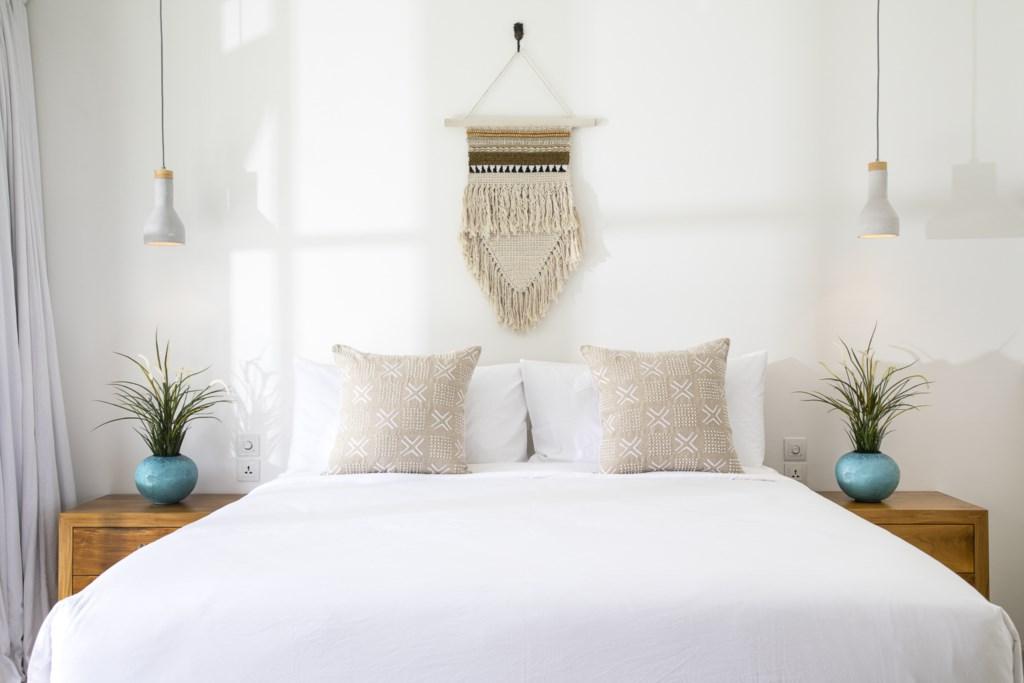 Bedroom 3 focus on bed (with vase).jpg