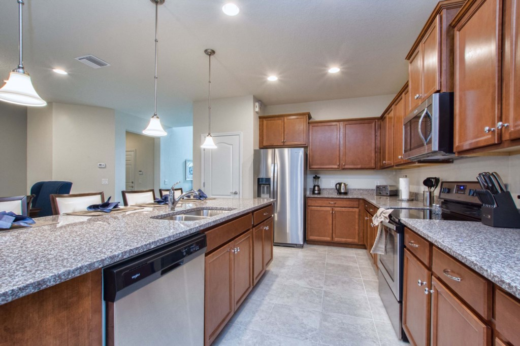 Kitchen with Stainless Steel Appliances and Granite Counter-tops