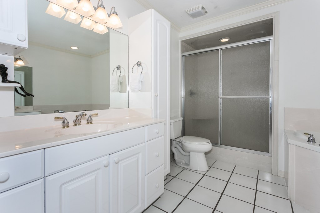 Large master bathroom with large soaking tub, walk in shower, and separate vanities.
