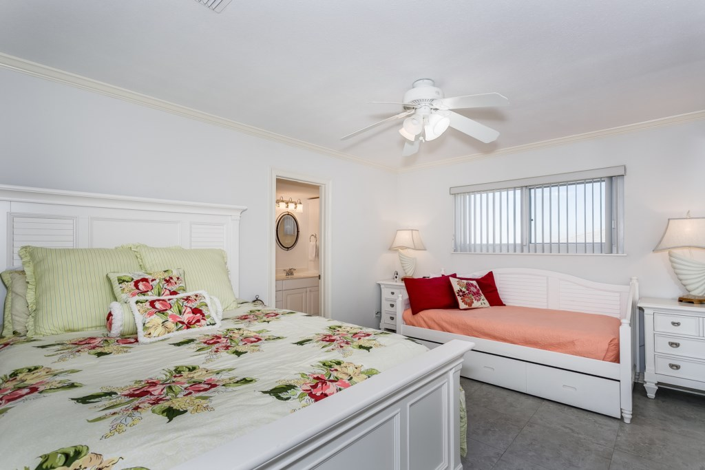 Second bedroom with queen bed and twin trundle bed