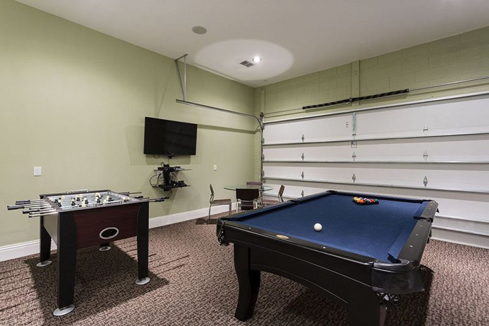 View 3 of exciting game room with flat screen TV, pool and foosball table