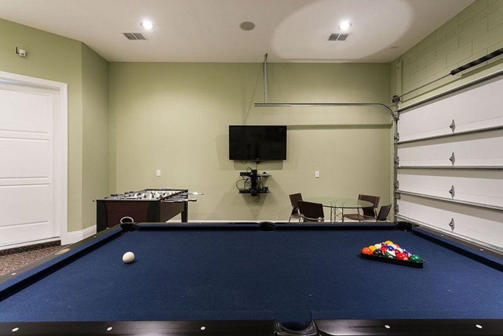 Exciting game room with flat screen TV, pool and foosball table