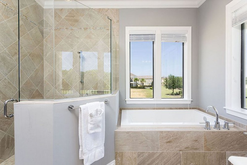 View 2 of beautiful master bathroom with tub and glass shower