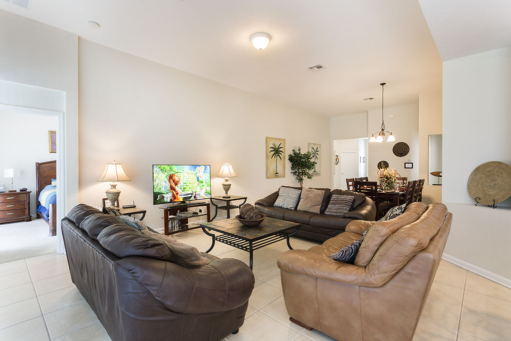 Cozy living room area with flat screen TV