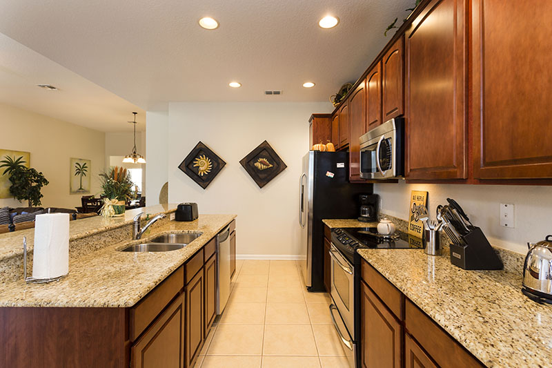 View 2 of beautiful kitchen area with microwave, oven, dishwasher, and double door refrigerator