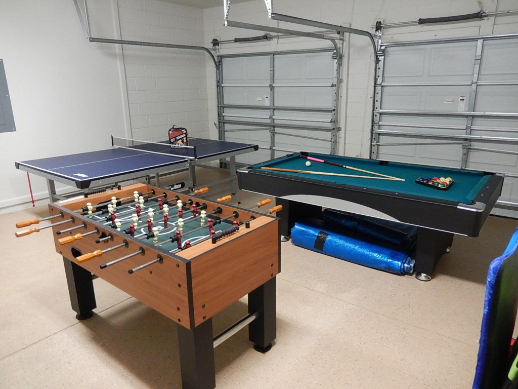 Exciting game room including foosball, ping pong and pool tables