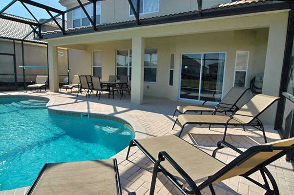 View 3 of luxurious pool and spa with loungers
