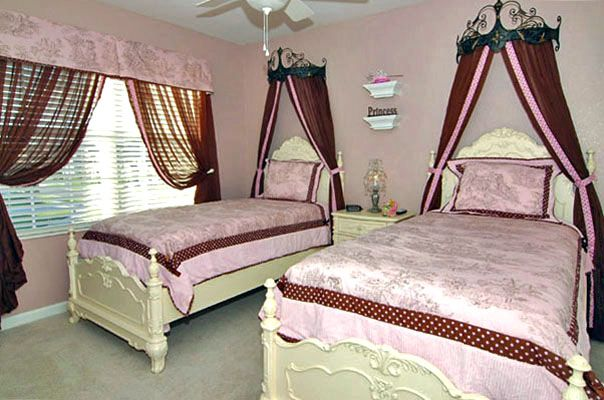 Adorable 2 twin princess themed beds with flat screen TV
