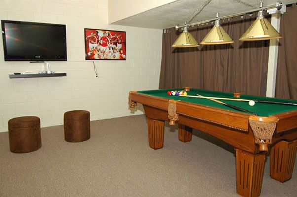 Awesome game room with pool table and flat screen TV