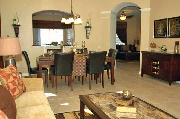 Gorgeous dining table by living room sofa and coffee table