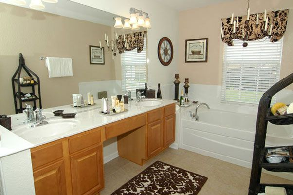 Classy master bathroom with double sink vanity, tub, and shower
