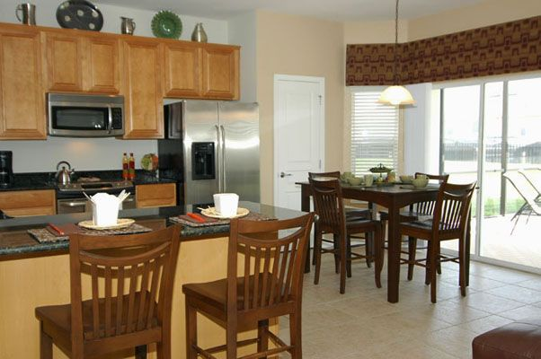 Amazing kitchen with barstool seating and table
