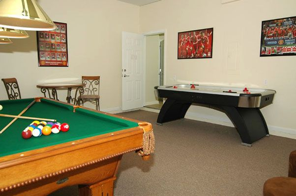 Awesome game room with pool table and hockey table
