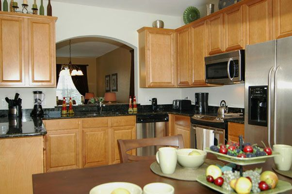 Classic style kitchen with double door refrigerator, stove, microwave, and dishwasher