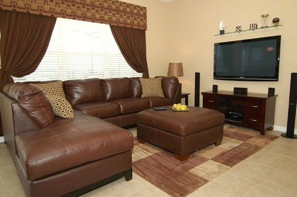 Stunning lounge area with comfortable sofa and flat screen TV