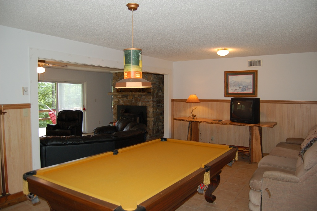 Pool table in basement area