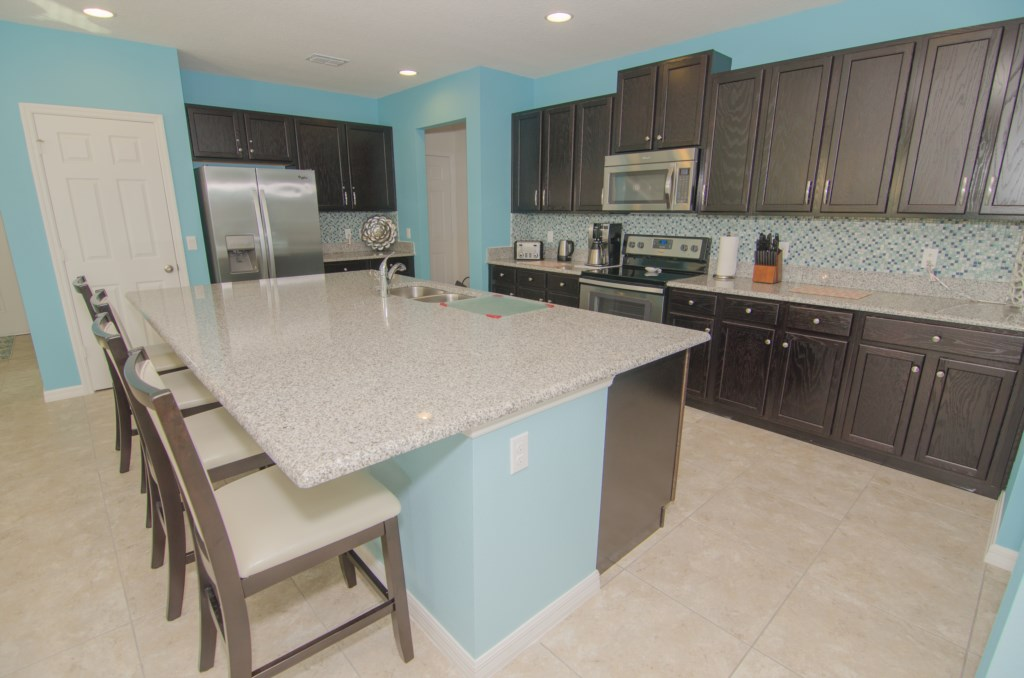 Kitchen w/Granite Counter tops & Stainless Steel Appliances