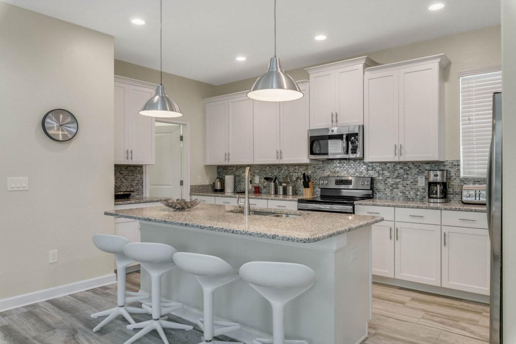 Kitchen with Granite Counter-tops and Stainless Steel Appliances