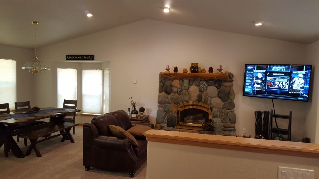 Fireplace in Den with TV and Comfy Couches