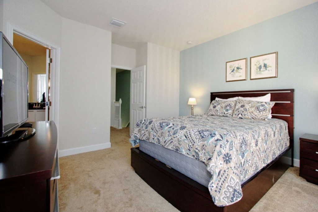 2ND FLOOR KING MASTER BEDROOM WITH ENSUITE, PRIVATE BALCONY AND FLAT SCREEN TV VIEW 2.jpg