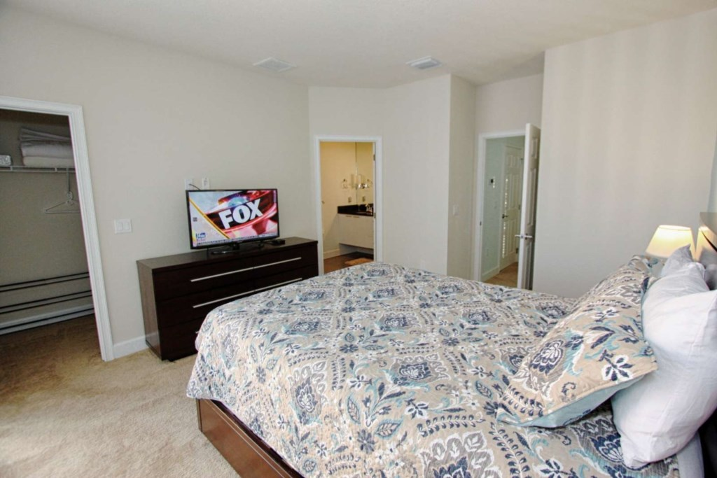 2ND FLOOR KING MASTER BEDROOM WITH ENSUITE, PRIVATE BALCONY AND FLAT SCREEN TV VIEW 3.jpg