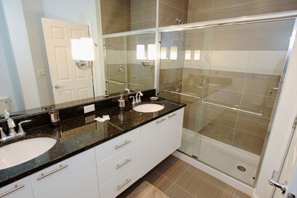2ND FLOOR MASTER KING ENSUITE BATHROOM WITH WALK IN SHOWER AND DOULE SINKS.jpg