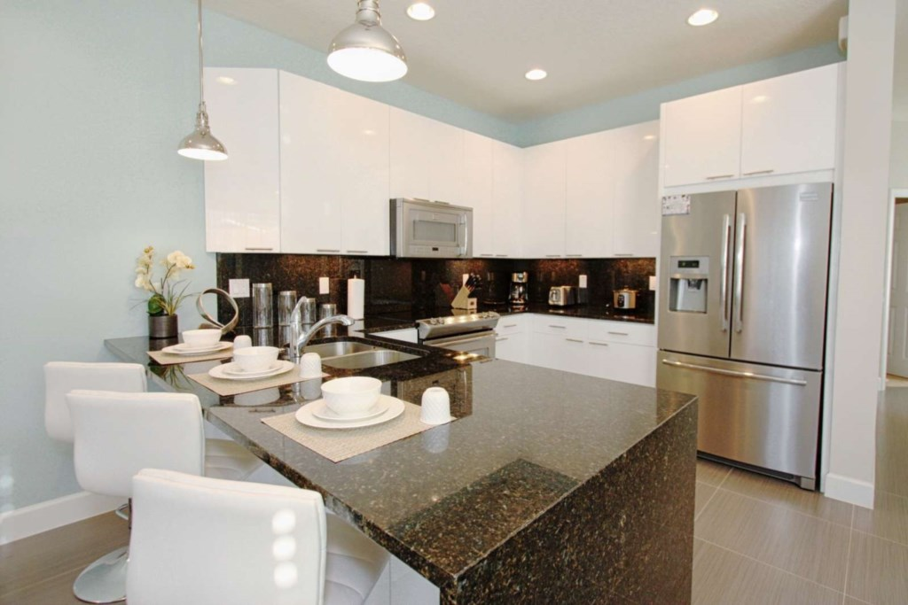 MODERN UPDATED KITCHEN WITH STAINLESS STEEL APPLIANCES AND GRANITE COUNTERS.jpg