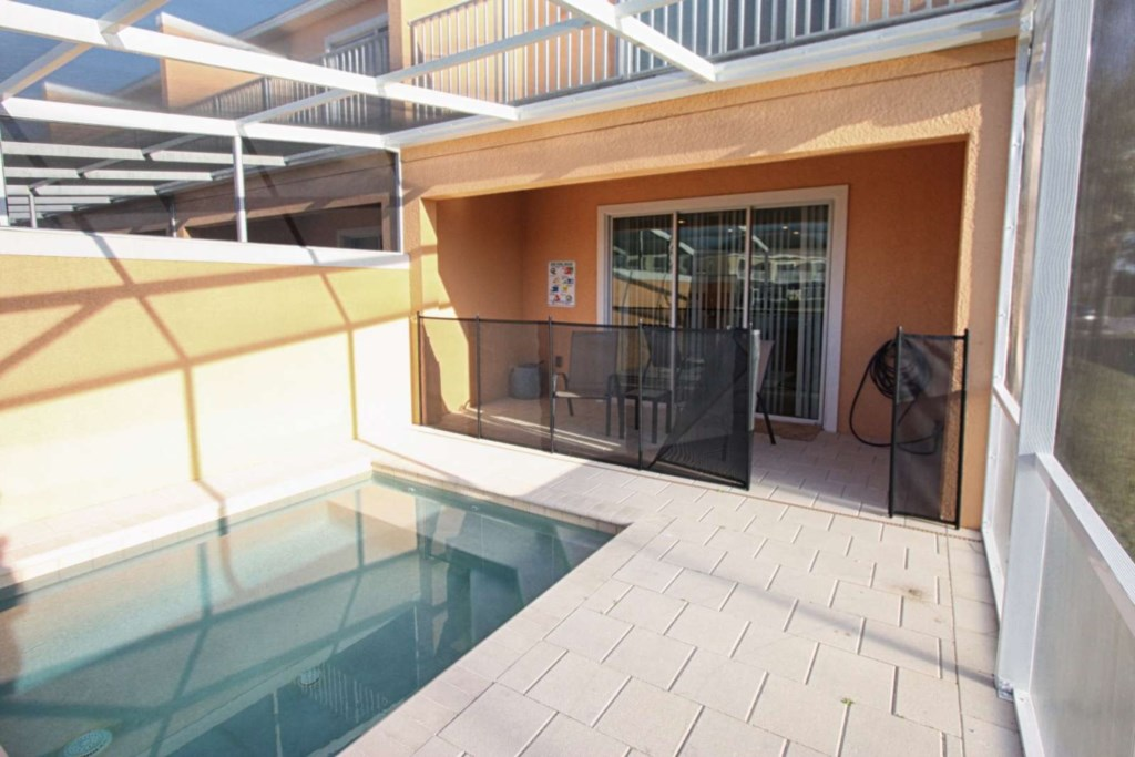 PRIVATE SPLASH POOL WITH SAFETY FENCE AND PATIO FURNITURE.jpg
