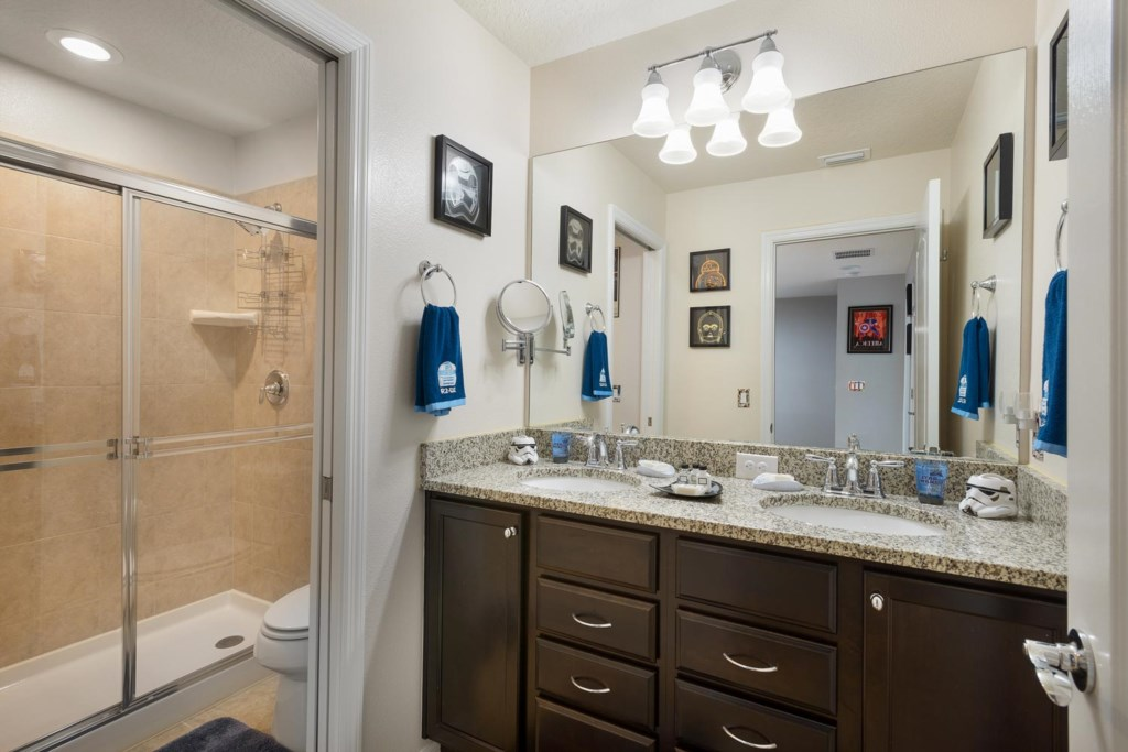 Upstairs Star Wars-themed bathroom 4 has two sinks and is located near bedrooms 4 and 5
