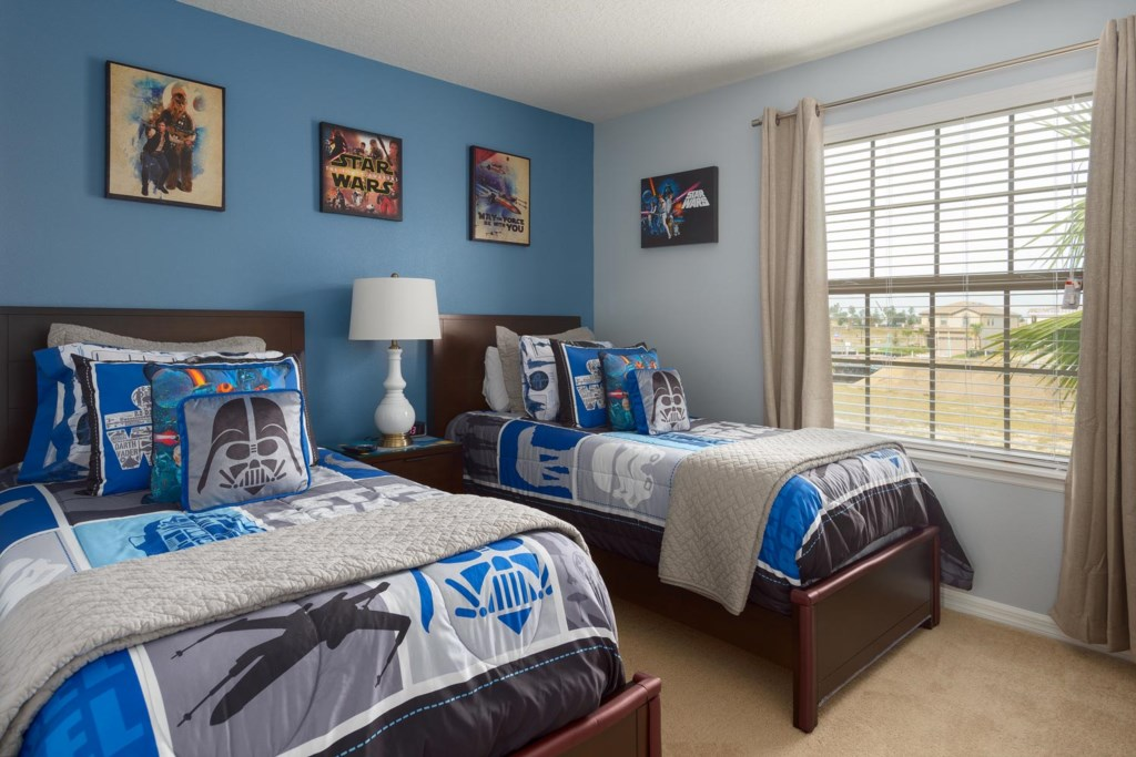 Upstairs Star Wars-themed twin bedroom 5 includes out-of-this-world bedding and artwork
