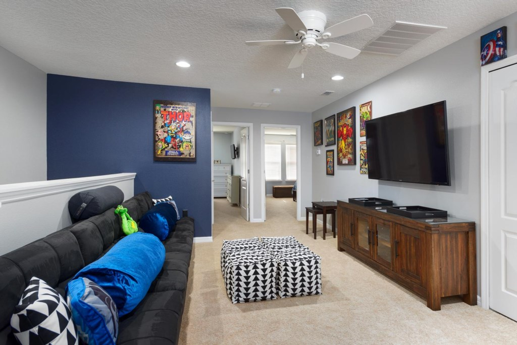 The entertainment area is made for fun with a 60-inch smart LED TV, Xbox One and two full futons