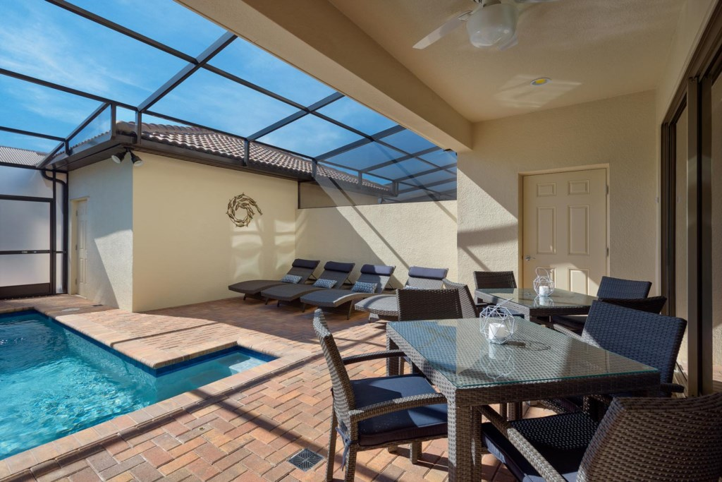 Experience this beautiful Windsor at Westside Town Home with a screened-in private pool and plenty o