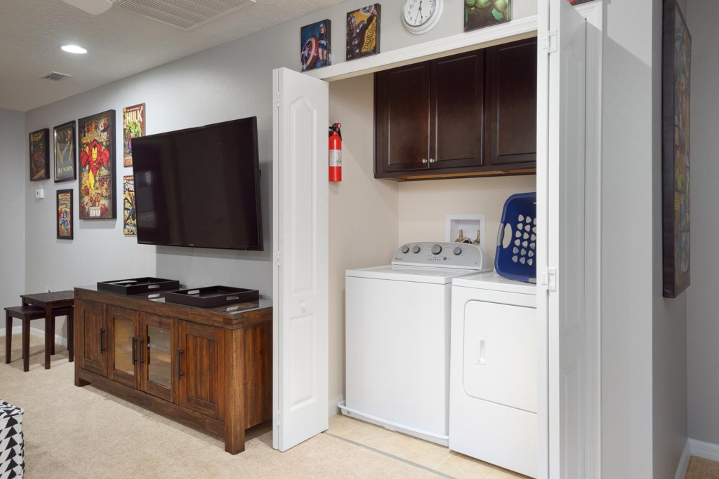 The laundry area features a washer and dryer so you can return from your vacation with clean clothes