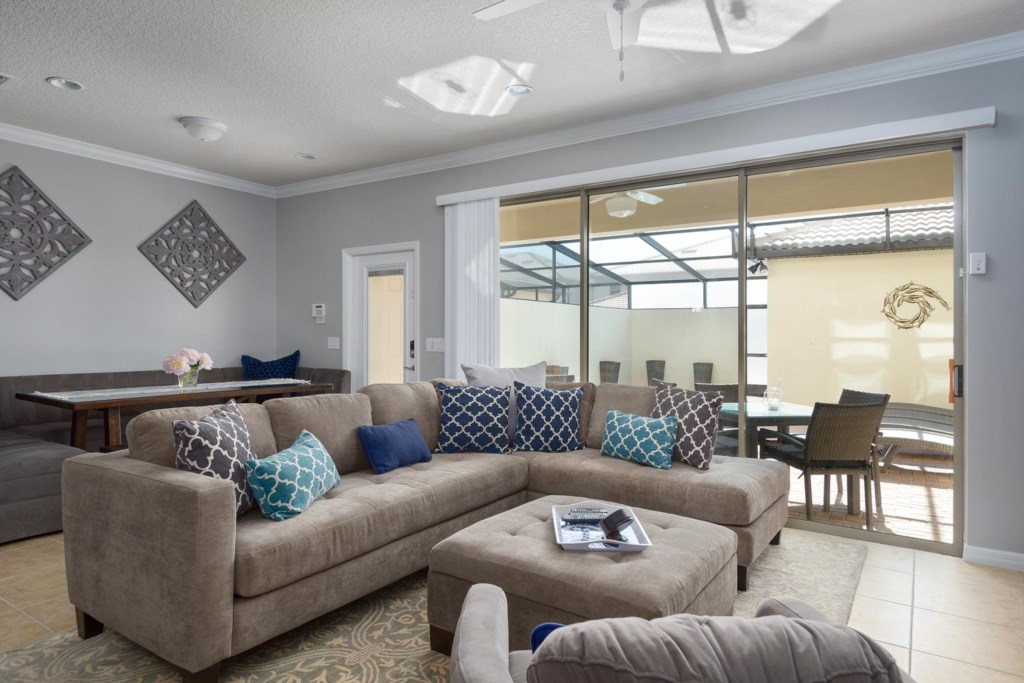 The open living and dining area offers views of the private pool