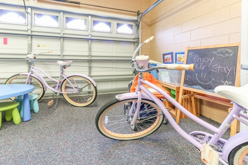 This home includes bikes, strollers and toys for the kids