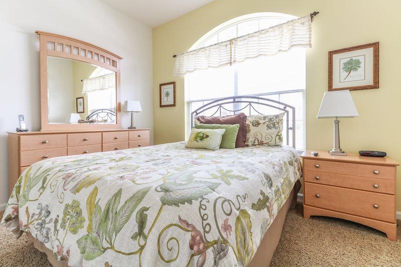 Queen bedroom with shared bathroom