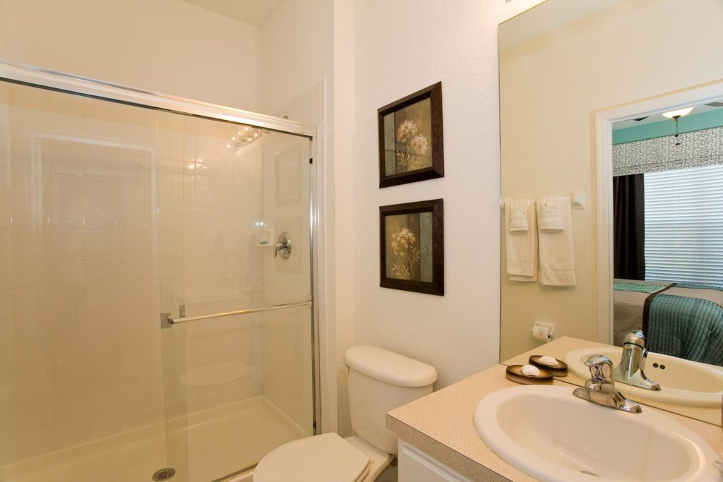 Suite 2 private bathroom with glass door shower and hall access