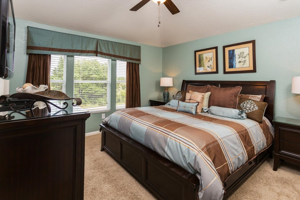 Inviting upstairs king suite 1 with 42-inch plasma TV and DVD player