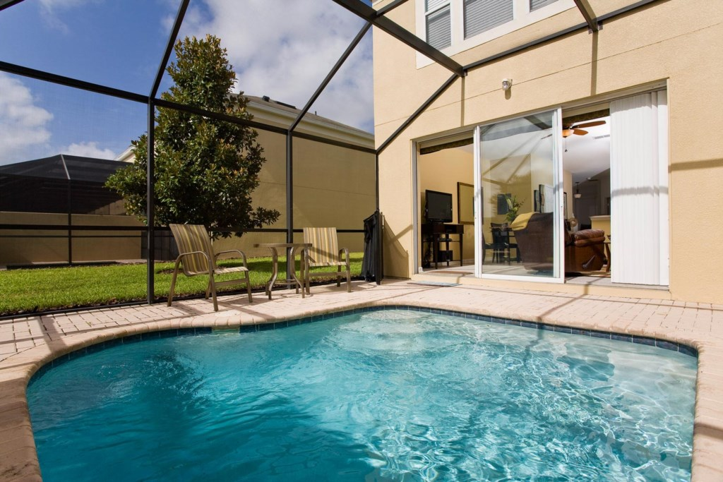 Private screened-in lounge pool with luxury patio furniture