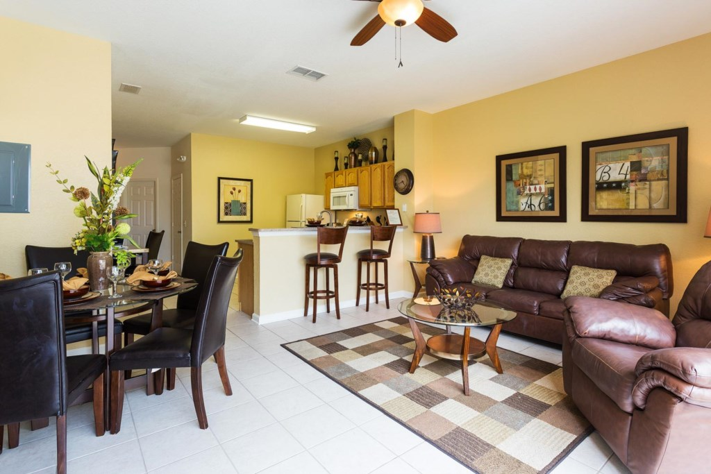 The living area is conveniently located near the kitchen and dining area