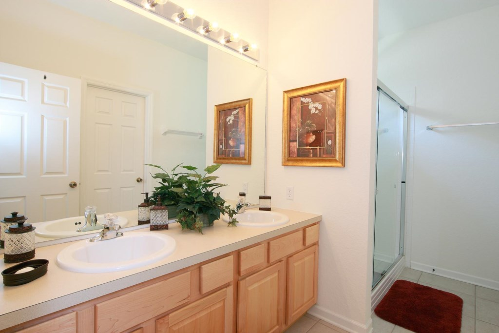Suite 1 private bathroom features two sinks and a glass door shower