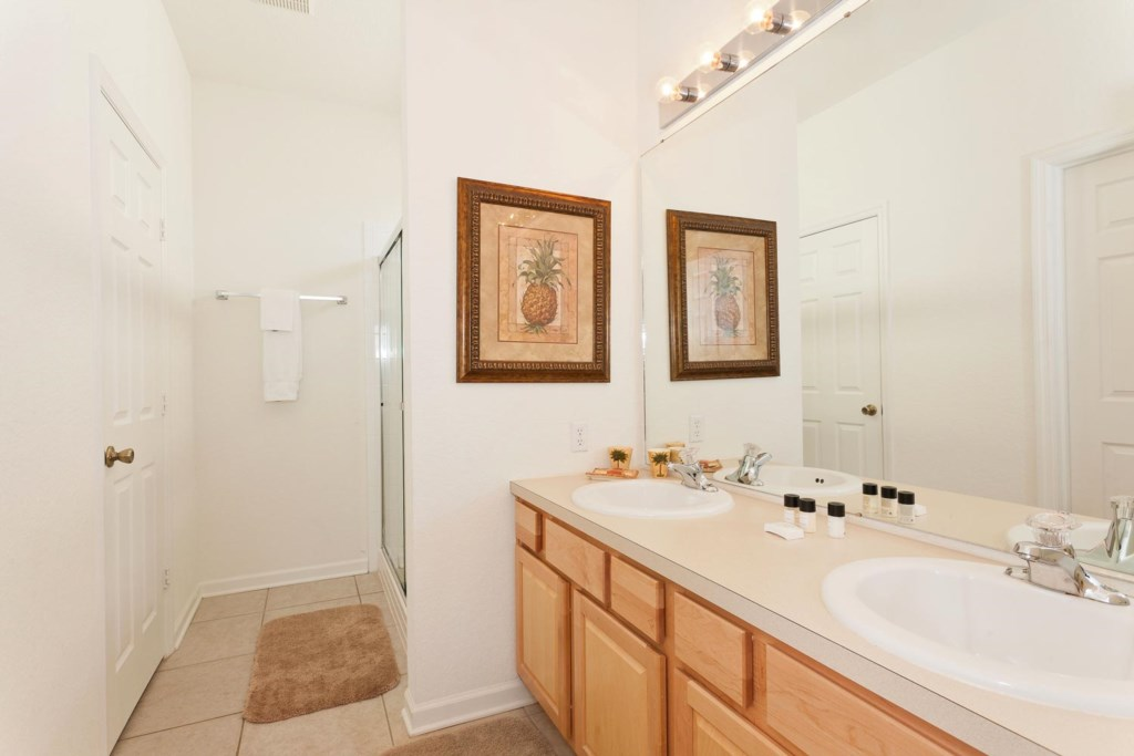 Suite 2 private bathroom with two sinks and a glass door shower