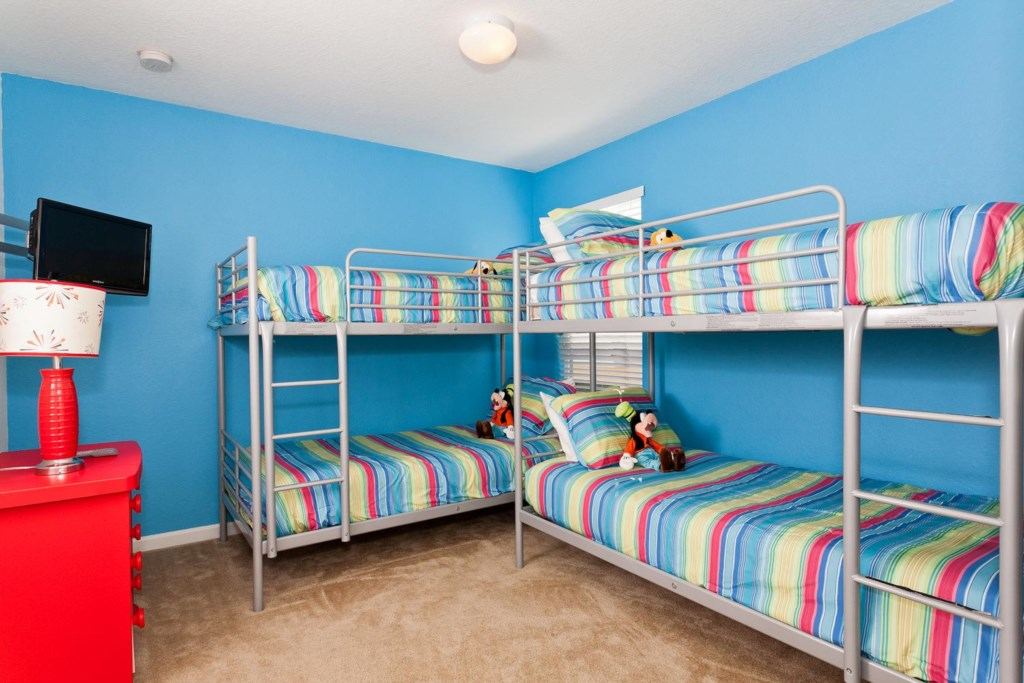 Fun upstairs bedroom 4 with two twin bunk beds and a 19-inch LCD TV/DVD combo