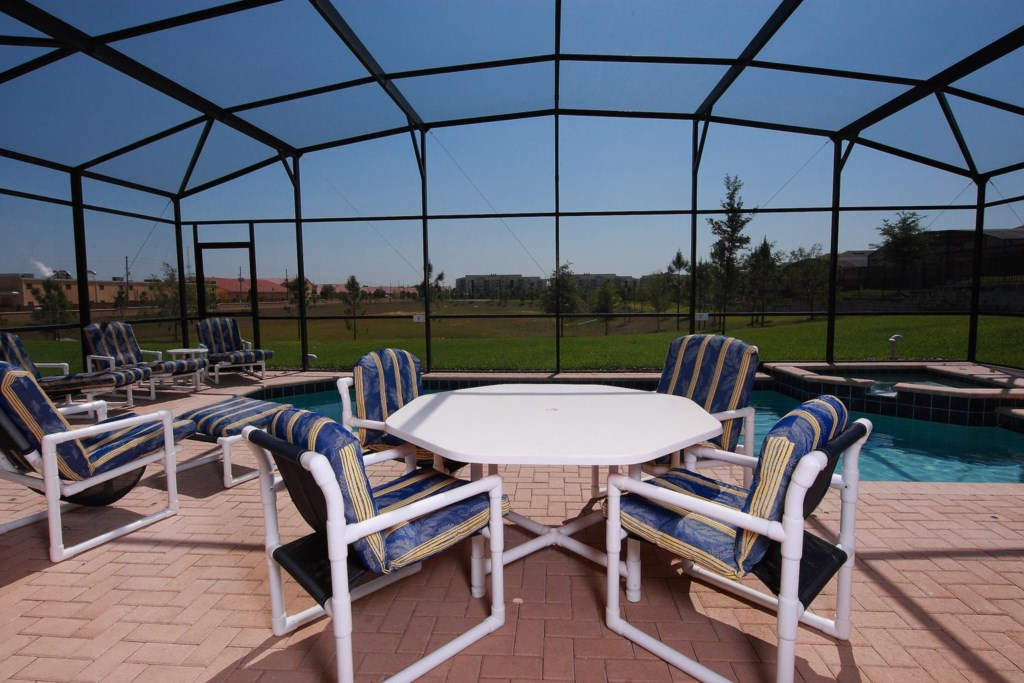 Take a dip in the pool, relax on one of the chaise loungers or enjoy dining on the spacious screened